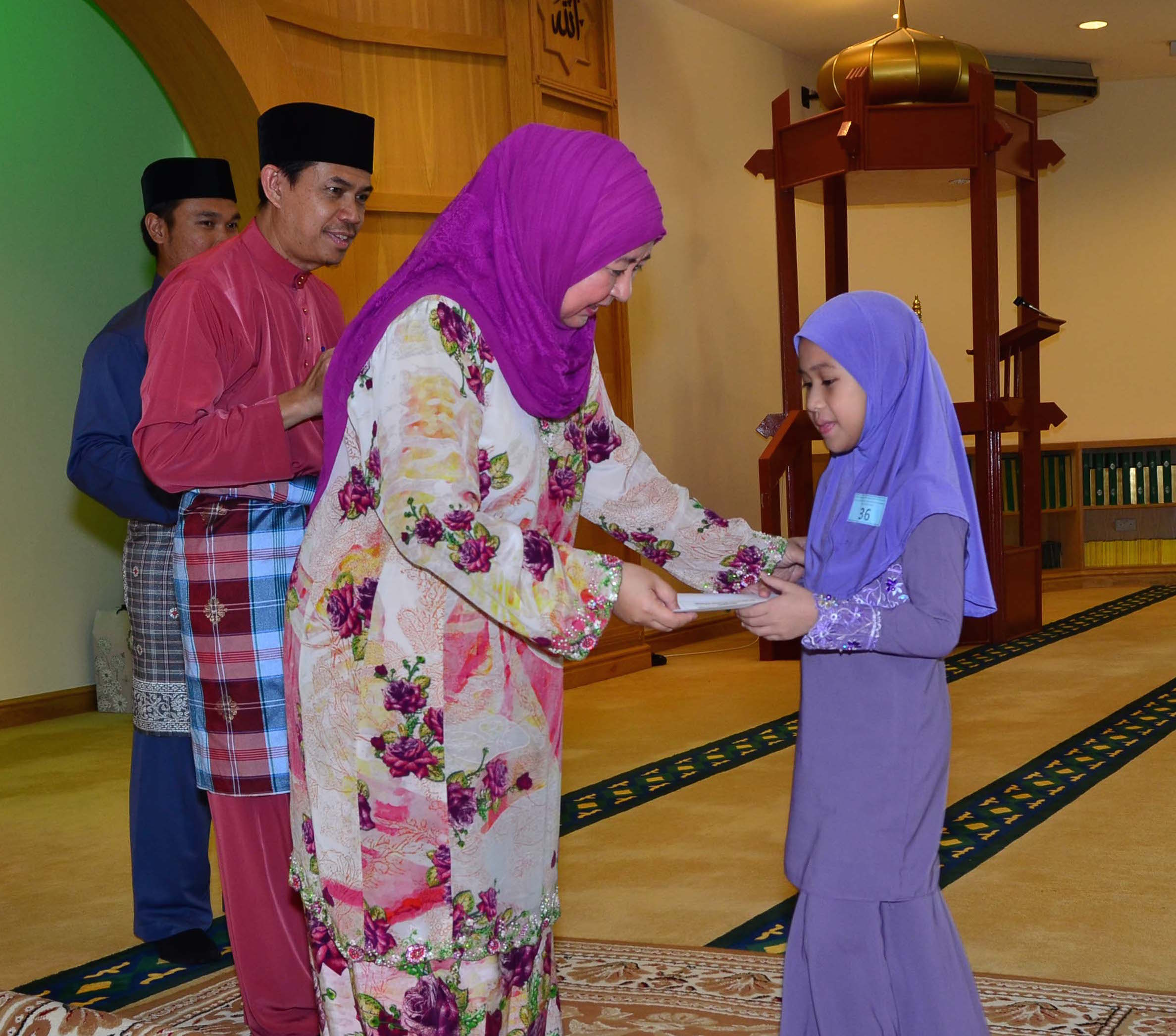 MINDEF HANDS OVER DONATIONS TO 56 ORPHANS